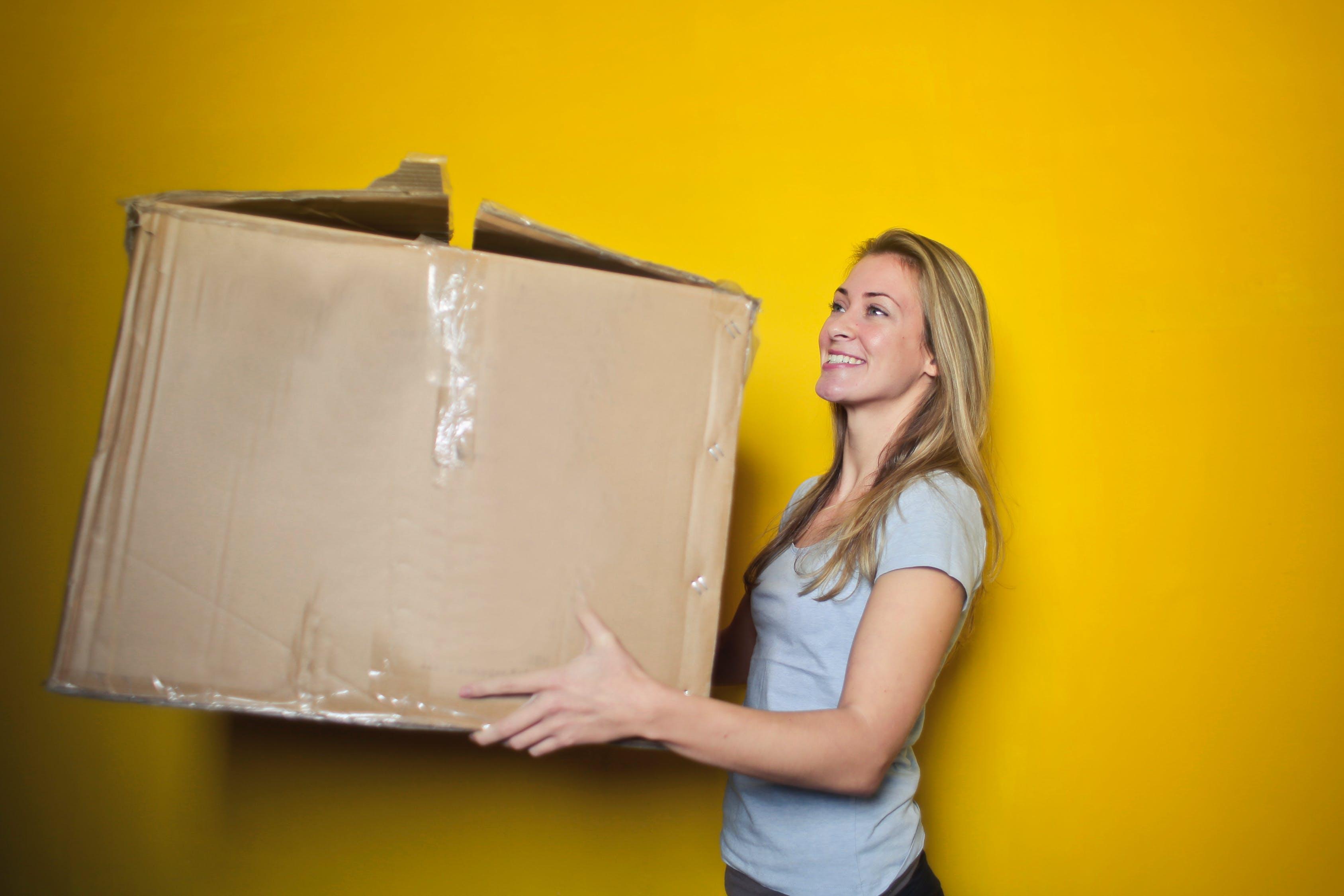 girl holding box